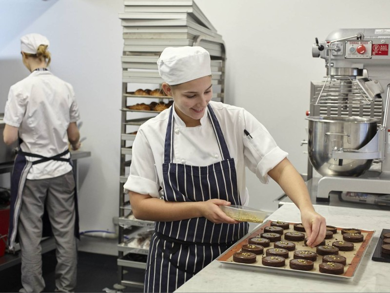 Pastry Chef Decorating Chocolate Tarts