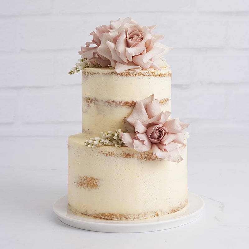 Celebration Cakes by Mrs Jones The Baker - The Lucy: Stunning two-tier naked wedding cake with fresh flowers serves 35 people
