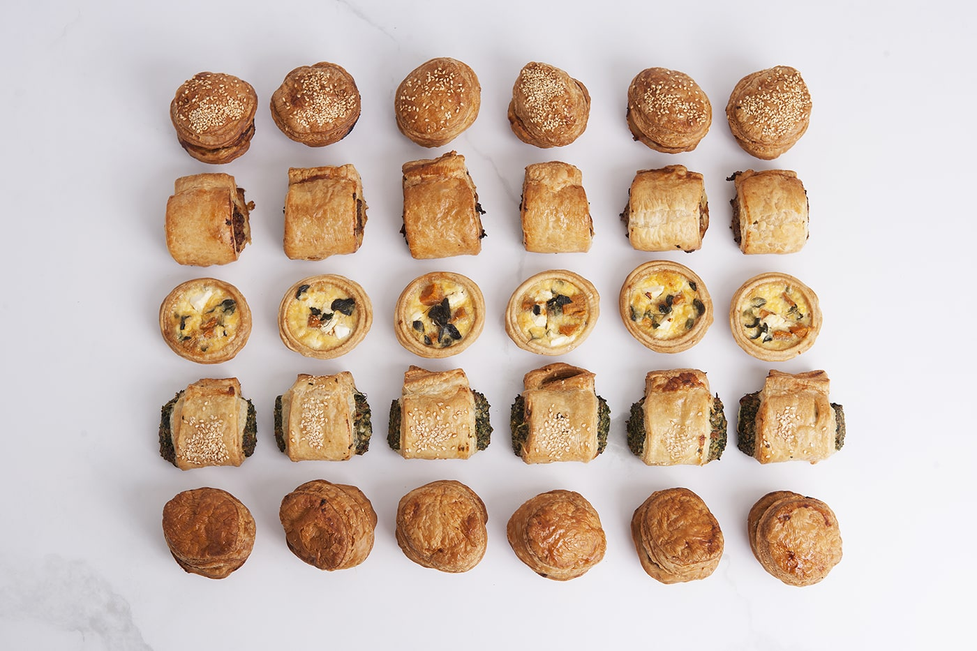 Ideal for a party or event, these mini pastries including pies, sausage rolls and quiches are delicisous.